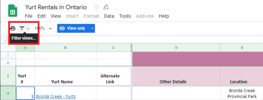 Click on the 'Filter views' icon located below the main Google Sheet toolbar