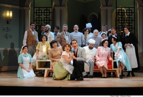 The chorus in DON PASQUALE. Pic Branco Gaica