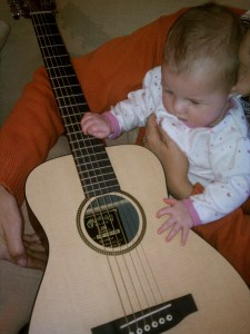 Checking out her new guitar