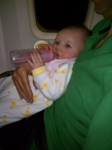 Holding her bottle on the airplane from NY to CO
