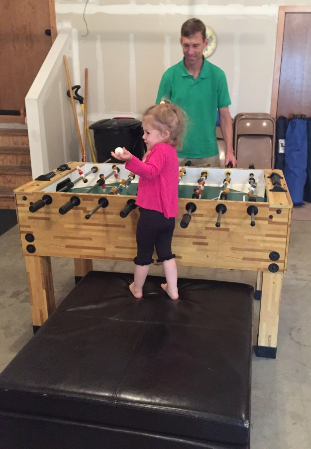 Dad and Sydney playing foosball in Washington