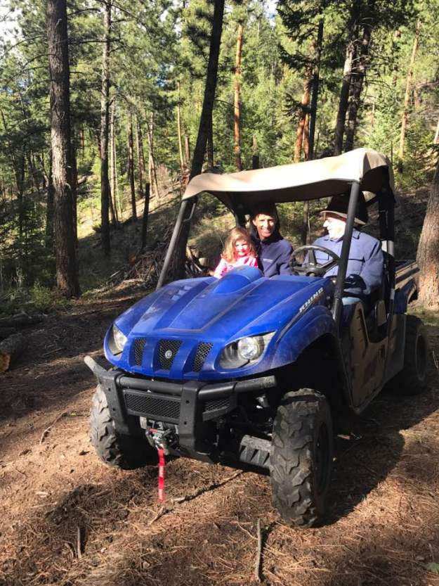 Riding the ATV to the picnic table in the woods