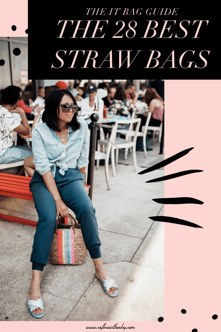 Summer Straw Bags featured by top US fashion blogger Sylvie in the Sky | Straw Bags by popular San Francisco fashion blog, Sylvie in the Sky: Pinterest image of a woman sitting outside on a red bench while wearing a blue denim shirt, blue pants, J.Crew blue slide sandals, black frame sunglasses, and holding a x REVOLVE St Tropez Leather Handle Tote KAYU brand:KAYU.
