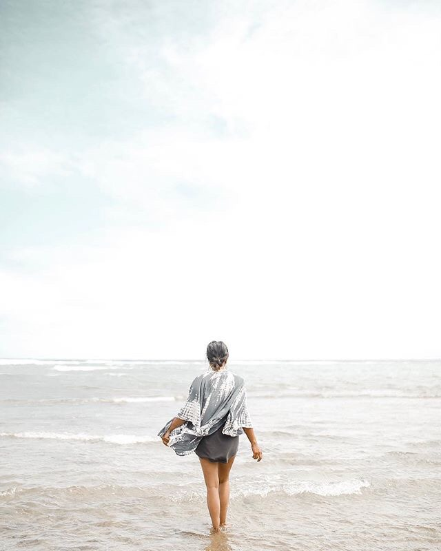 Beach Living by the Sea by popular San Francisco lifestyle blog, Sylvie in the Sky: image of a woman standing in the ocean.
