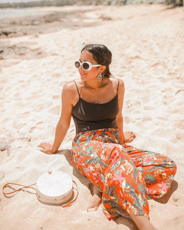 Positive Habits featured by top US life and style blogger Sylvie in the Sky; Image of a woman sitting on the beach.