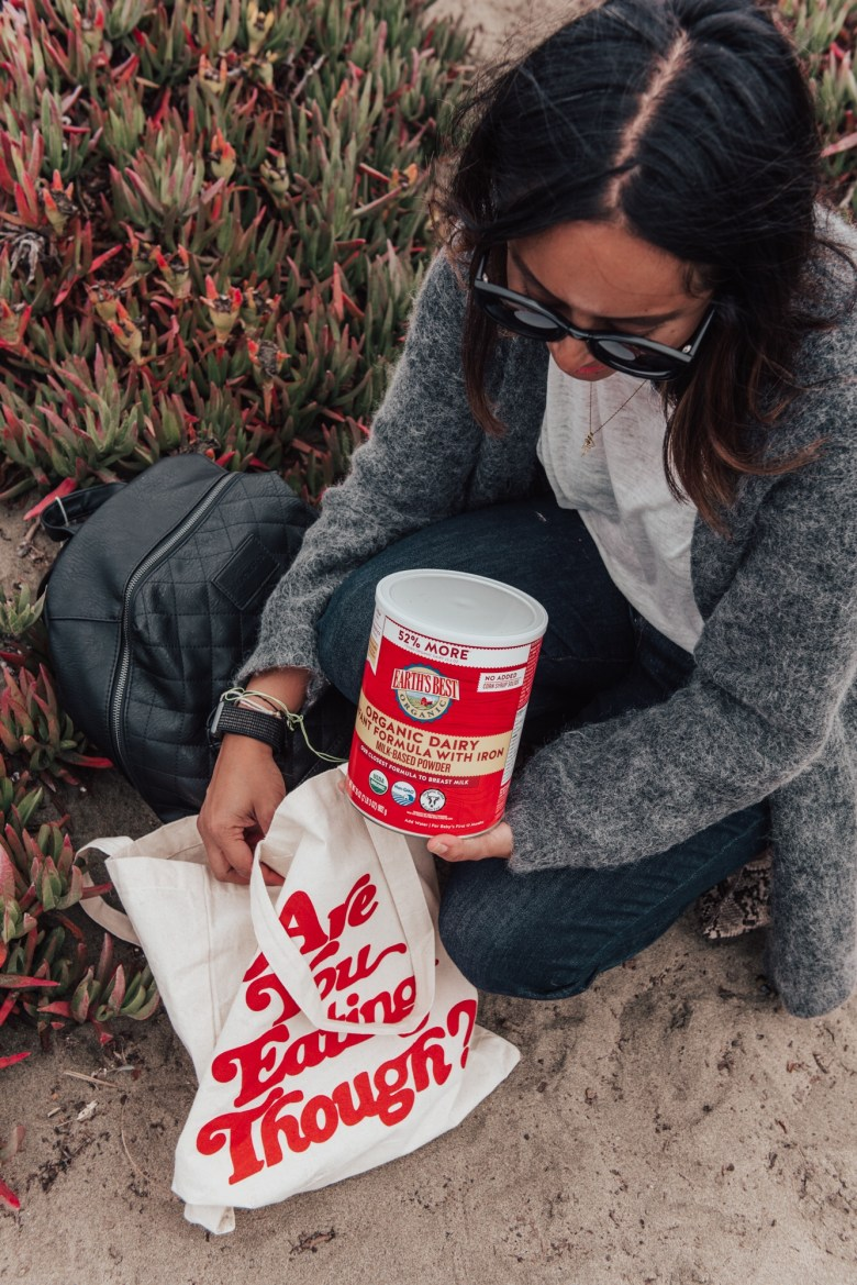 The Best Breastfeeding Essentials by popular California mommy blog, Sylvie in the Sky: image of a woman holding a canister of Earth's Best Organic Dairy infant formula.