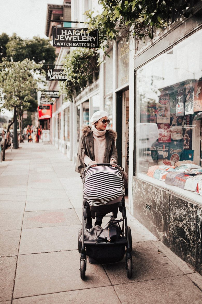8 Smart Holiday Shopping Tips by popular San Francisco life and style blog, Sylvie in the Sky: image of a mom pushing a baby stroller by Haight jewelry.