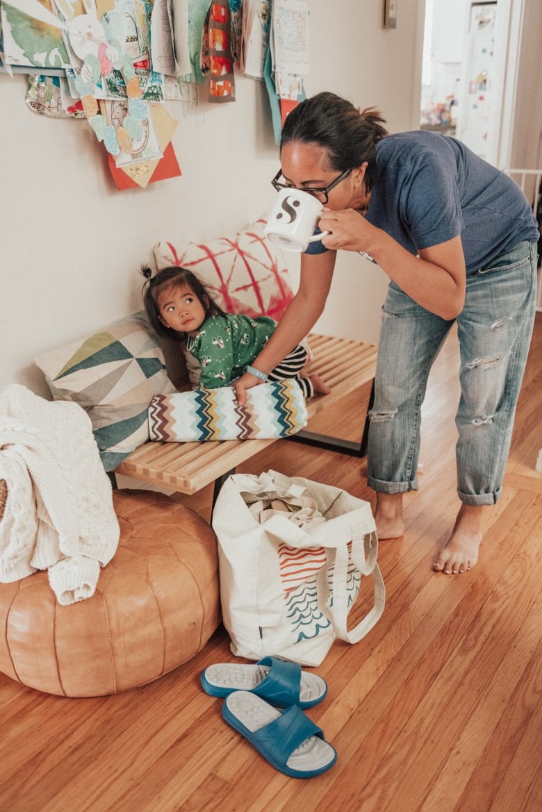 10 Best Baby Proofing Products for Every Home by popular San Francisco mom blog, Sylvie in the Sky: image of a mom standing next to her toddler age daughter who is climbing on to a wooden bench.