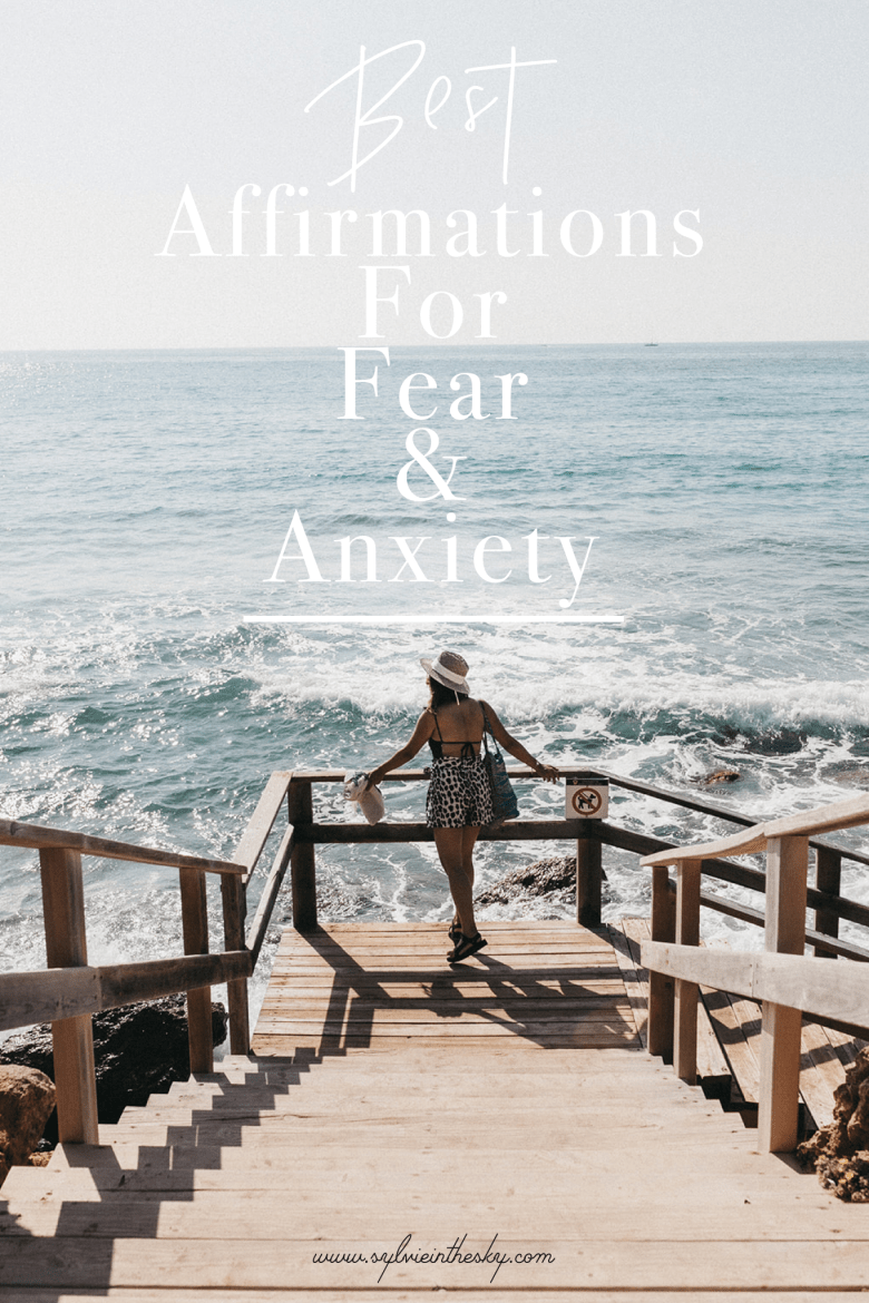 Powerful Affirmations by popular San Francisco lifestyle blog, Sylvie in the Sky: Pinterest image of a woman standing on some wooden stairs that lead down to the beach.