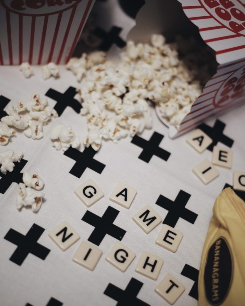 At Home Halloween by popular San Francisco motherhood blog, Sylvie in the Sky: image of popped popcorn and Bananagrams.