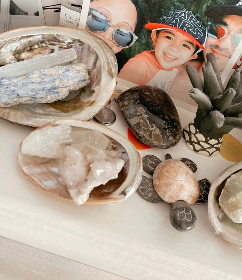 Healing Crystals for Beginners by popular San Francisco lifestyle blog, Sylvie in the Sky: image of crystals n shells next to a family picture.