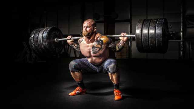 A man squatting with a barbell