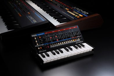 Roland-JU06A-dramatic-lighting-angle-with-predecessor-JUNO-synths