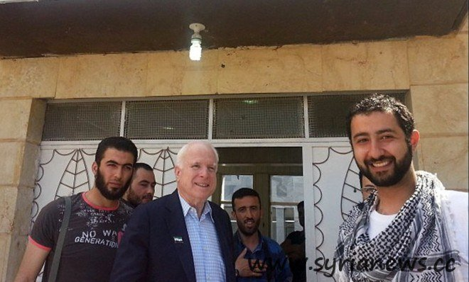 US loose senator John McCain in a memorial picture with the kidnappers of Lebanese men