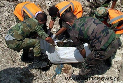 Syria: Mass Grave with charred Syrian citizens in Latakia (Source: FNA)