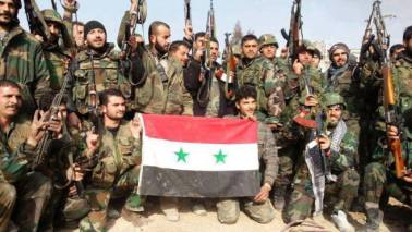 Soldiers with Syrian flag