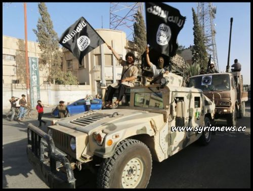 image-ISIS Terrorists parading US weapons