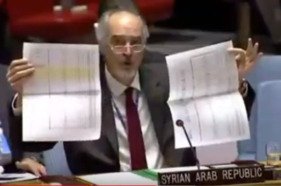 Jaafari holds documents from sarc. 182 intra-syrian convoys deployed this year