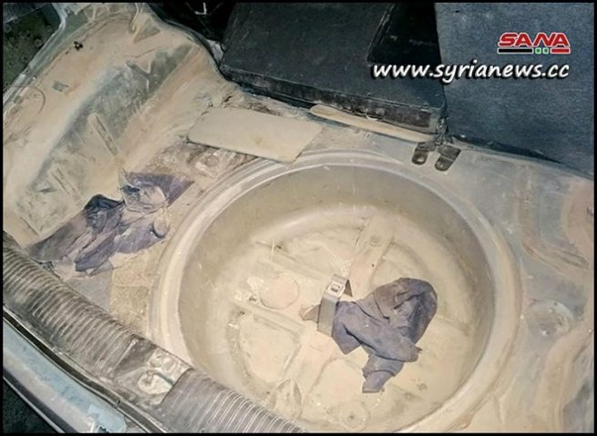Trunk of the booby-trapped car dismantled in Al-Zahraa district - Homs - Syria