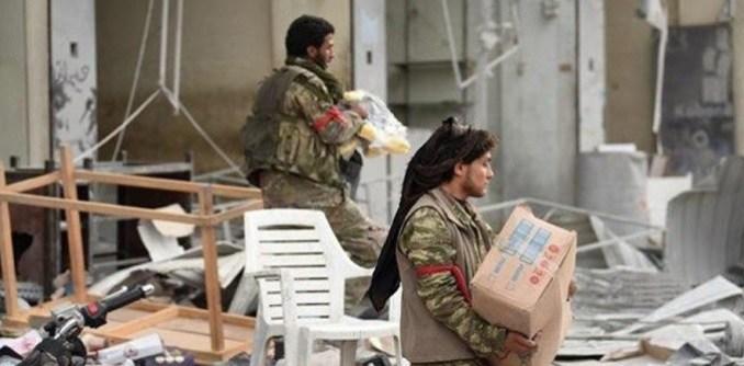 Erdogan terrorists looting Syrians' belongings.