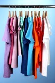 17054366-variety-of-casual-shirts-on-wooden-hangers-on-blue-background