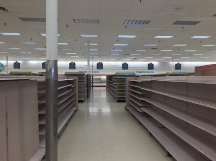 Empty_shelves_in_a_closing_Winn-Dixie