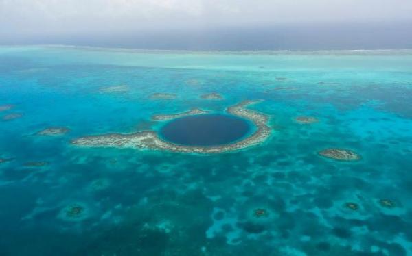 flying over blue hole belize