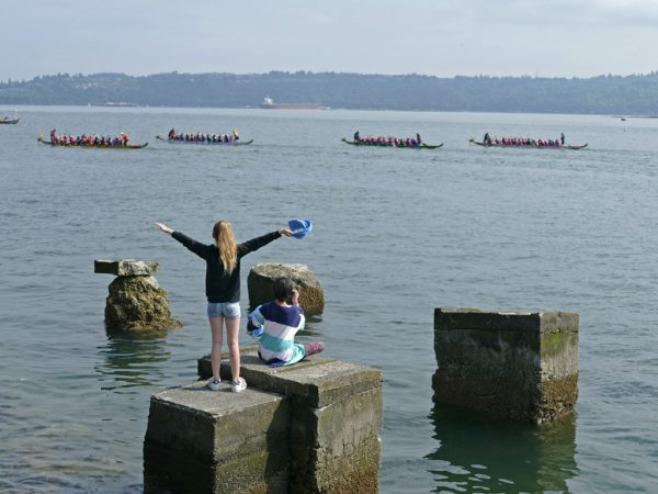 Photo of kids cheering for the paddlers