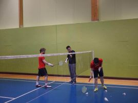 Coach Andrew explains the right grip to one of the player.