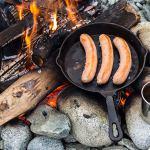 cast iron cookware over open fire
