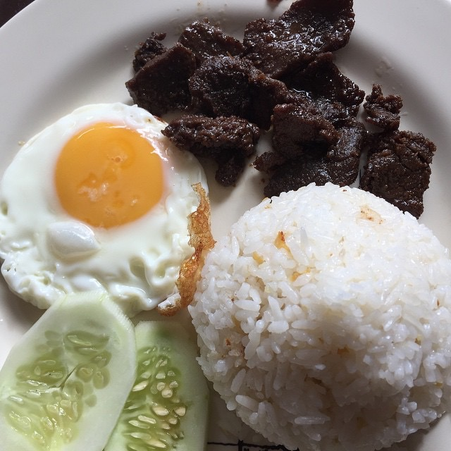 Tapsilog with sliced cucumbers