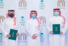 """صورة توقيع مذكرة تفاهم بين الأولمبية السعودية وشركة """"ماجد الفطيم العقارية"""""""