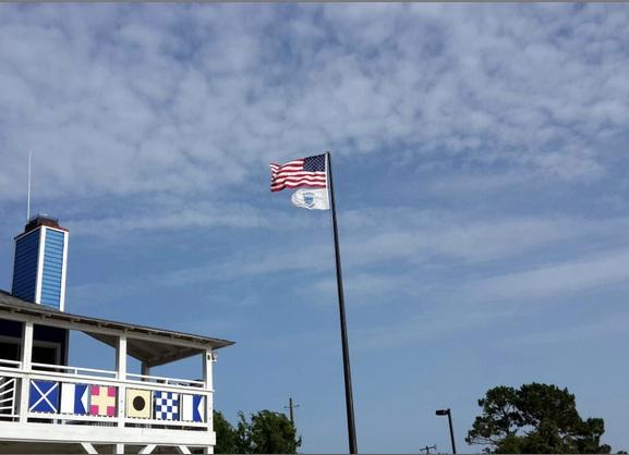 US flag over marina