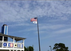 US flag over marina