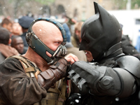 Batman (Christian Bale) and Bane (Tom Hardy) battle in 'The Dark Knight Rises'
