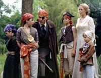 From left to right: Freddie Highmore, Joe Prospero, Johnny Depp, Nick Roud, Kate Winslet and Luke Spill star in 'Finding Neverland'