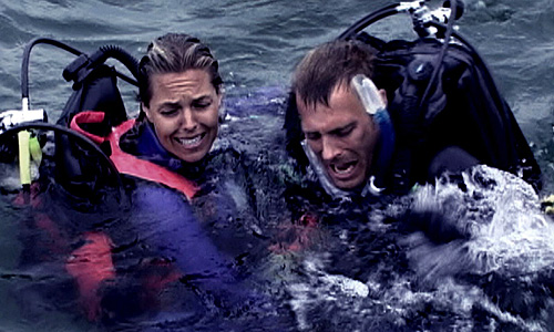 Blanchard Ryan (left) and Daniel Travis struggle to keep their heads above water in 'Open Water'