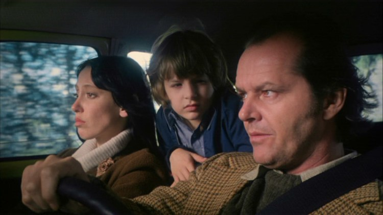 Shelley Duvall (left), Danny Lloyd and Jack Nicholson head to the Overlook Hotel in 'The Shining'