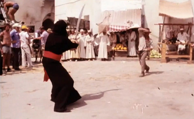 Harrison Ford duels with swordsman with his whip in 'Raiders of the Lost Ark'