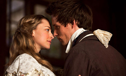 Cosette (Amanda Seyfried) and Marius (Eddie Redmayne) find love in a France at war with itself in 'Les Miserables'