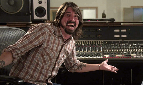 Dave Grohl next to the legendary Neve console that he now owns