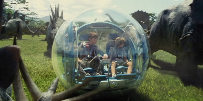 Ty Simpkins and Nick Robinson enjoy a ride in 'Jurassic World'