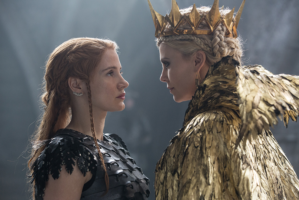 "(L to R) Warrior Sara (JESSICA CHASTAIN) faces off against the Evil Queen Ravenna (Oscar® winner CHARLIZE THERON) in the story that came before Snow White: ""The Huntsman: Winter's War."" Chris Hemsworth and Theron return to their roles from ""Snow White and the Huntsman,"" joined by Emily Blunt and Chastain."