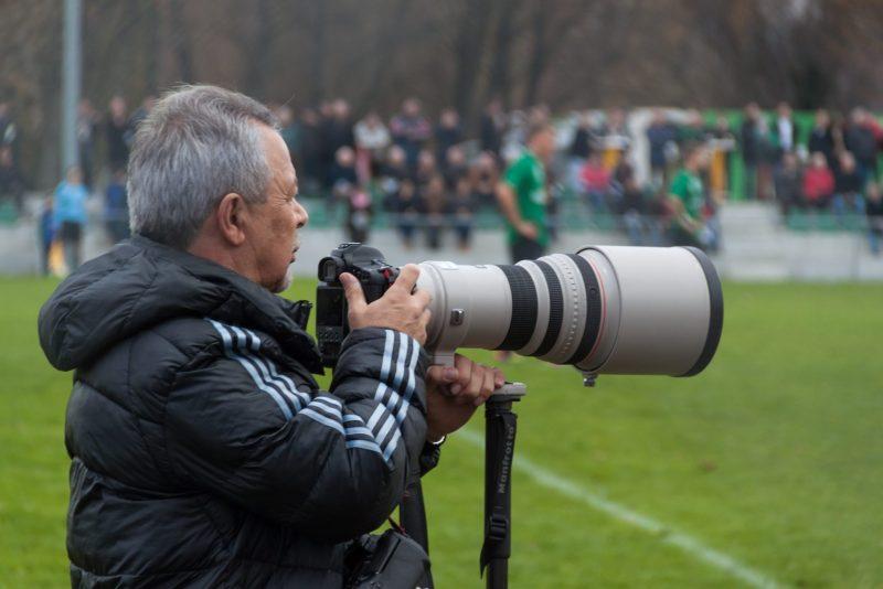 Sport photographer at a football match