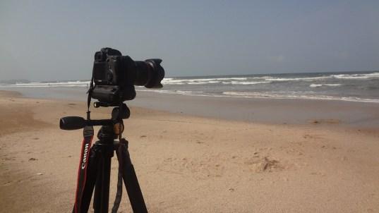 DSLR Camera on a tripod on a deserted beach