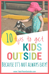 Young toddler wearing a pink sunhat petting a baby goat - text reads: 10 tips to get kids outside because it's not always easy