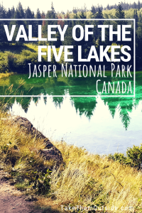A turquoise lake bordered by trees, found at Valley of the Five Lakes in Jasper
