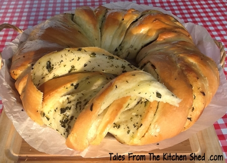 Garlic & Herb Twister Bread is perfect for sharing! Who can resist soft warm bread straight from the oven filled with garlic and herb butter?