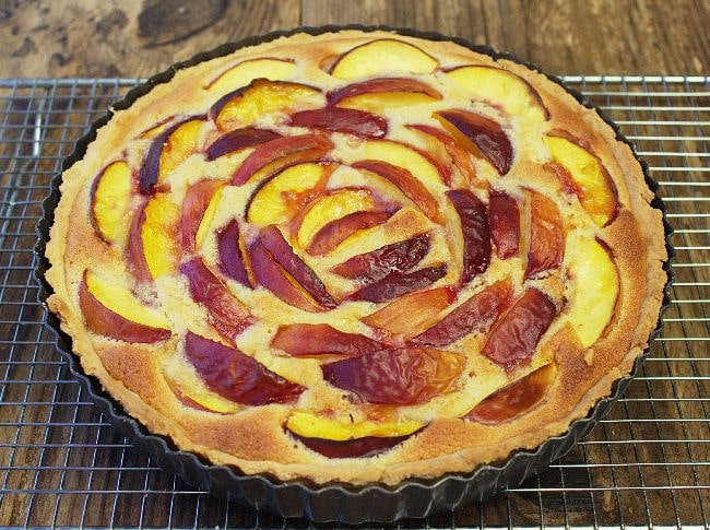 Nectarine Frangipane Tart. An easy all in one almond paste & soft juicy nectarines in a rich buttery pastry case - the perfect summer dessert!