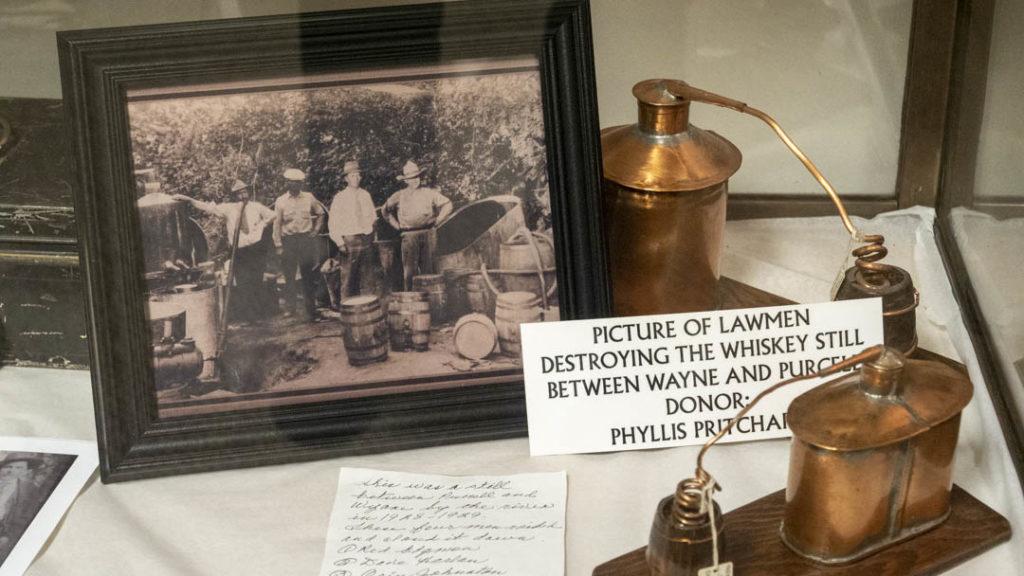 Photo of Lawmen destroying whiskey still
